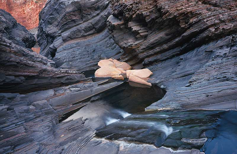 image of River rocks and stream, Karijini Nat Park, WA