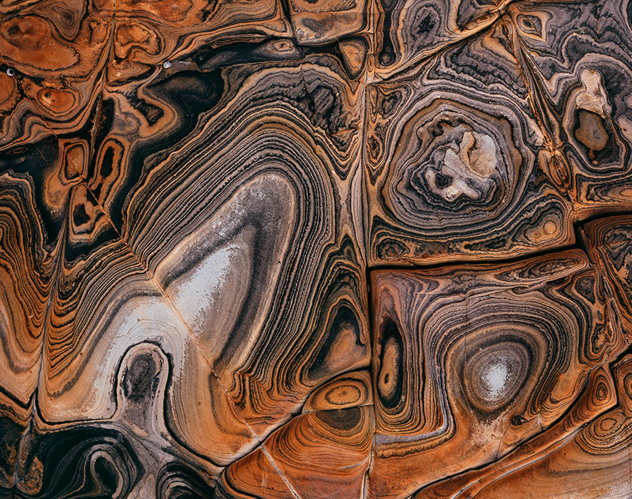 image of 'Red swirls', ( rock detail ), Tasmania